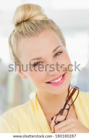 Closeup portrait of a beautiful young woman against blurred background