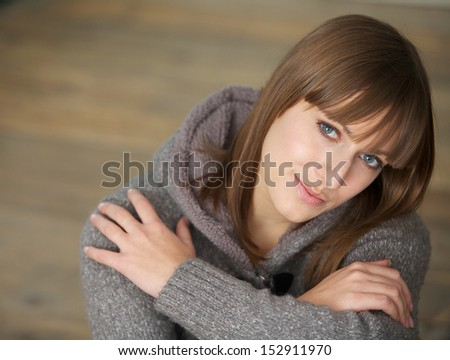Closeup portrait of a beautiful young woman looking at camera - stock photo