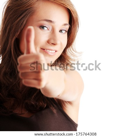 Closeup portrait of a beautiful young woman showing thumbs up sign  - stock photo