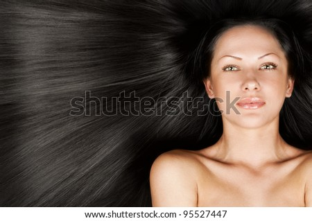 closeup portrait of a beautiful young woman with elegant black long shiny hair , concept hairstyle