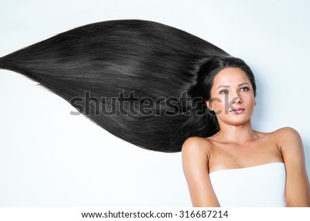 closeup portrait of a beautiful young woman with elegant long shiny hair , hairstyle , isolated on white background - stock photo