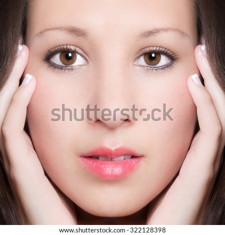 Closeup portrait of a beautiful young woman with perfect skin, beauty concept - stock photo
