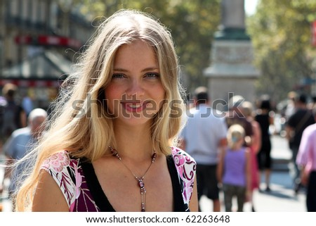 Closeup portrait of a blond lady on vacation - stock photo