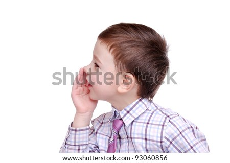 Closeup portrait of a boy whispering gossips against white background