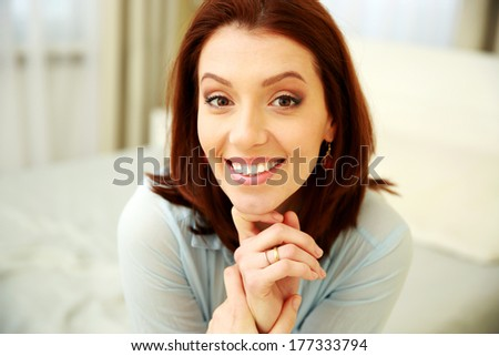 Closeup portrait of a cheerful woman - stock photo