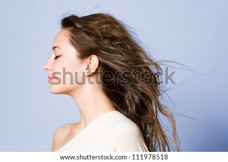 Closeup portrait of a cheerful young brunette beauty. - stock photo
