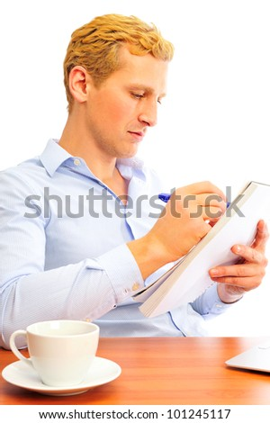 Closeup portrait of a cheerful young business man signing documents