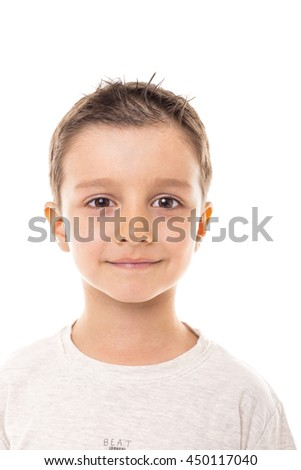 Closeup portrait of a cute little boy over white background - stock photo