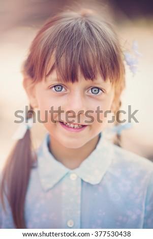 Closeup portrait of a cute Little girl - stock photo