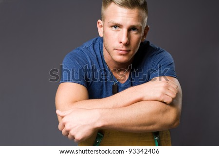 Closeup portrait of a friendly very handsome young man. - stock photo
