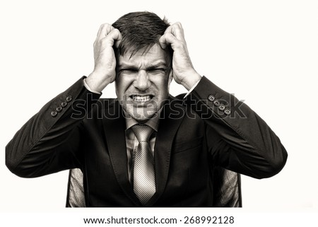 Closeup portrait of a frustrated businessman pulling his hair isolated on white background - stock photo
