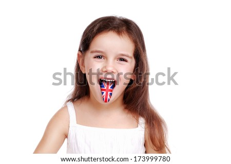 Closeup portrait of a girl showing tongue with british flag on it