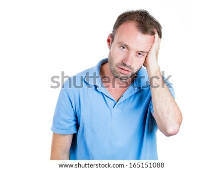 Closeup portrait of a groggy upset worried sad, depressed, tired business man with a headache and very stressed hand in hair, isolated on white background, Negative human emotion facial expression - stock photo