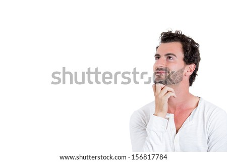 Closeup portrait of a handsome young man resting chin on hand, looking happy, daydreaming, staring thoughtfully upwards, copy space to left, isolated on white background. Positive human emotions - stock photo