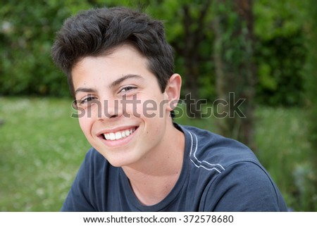 Closeup portrait of a handsome young man smiling  - stock photo