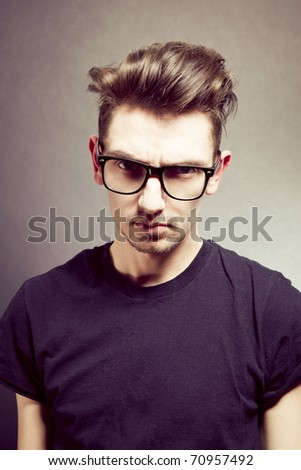 Closeup portrait of a handsome young man wearing glasses