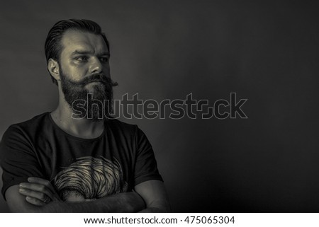 Closeup portrait of a handsome young man with retro look over gray background