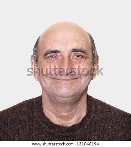 Closeup portrait of a happy aged man - stock photo