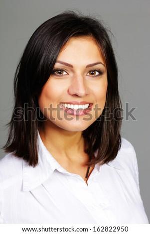 Closeup portrait of a happy confident beautiful woman  - stock photo