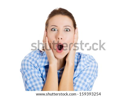 Closeup portrait of a happy cute young beautiful woman looking excited and surprised in full disbelief, isolated on a white background with copy space. Positive human emotions and facial expressions - stock photo