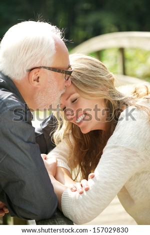 Closeup portrait of a happy daughter standing close to father - stock photo