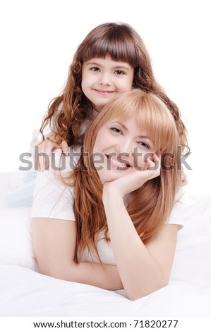 Closeup portrait of a happy family mother and daughter