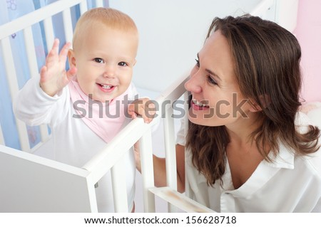 Closeup portrait of a happy mother and child with happy expression on face