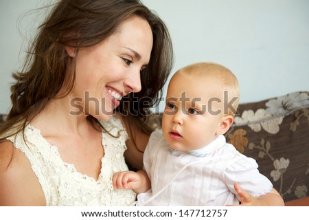 Closeup portrait of a happy mother smiling at cute baby
