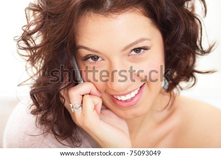 Closeup portrait of a happy smiling woman talking on phone
