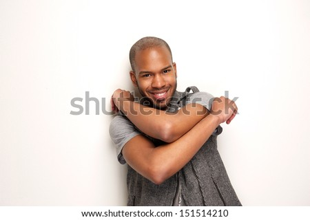Closeup portrait of a happy young man smiling with arms crossed - stock photo