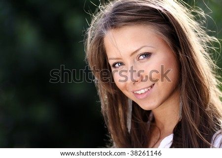 Closeup portrait of a happy young woman