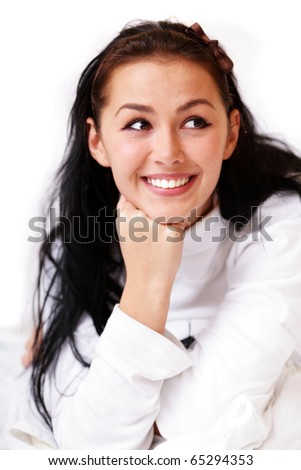 Closeup portrait of a happy young woman looking to side - stock photo