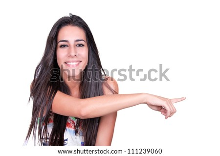 Closeup portrait of a happy young woman pointing at something interesting against white background - stock photo