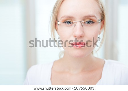 Closeup portrait of a intelligent young woman wearing glasses, copyspace