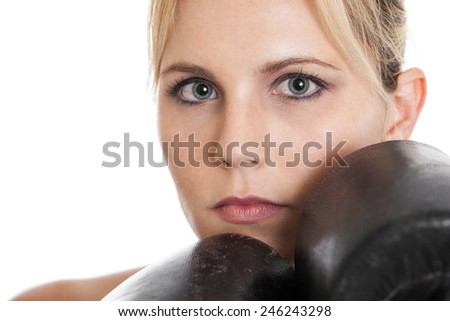 Closeup portrait of a late 20s beautiful boxer with gloves protecting face isolated on a white background - stock photo