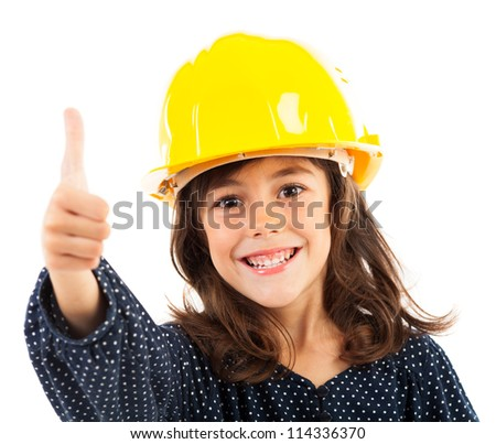 Closeup portrait of a little girl with yellow helmet showing thumbs up, isolated on white background