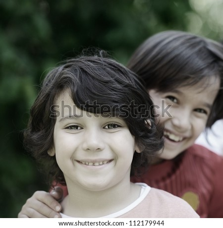 Closeup portrait of a little happy boy outside - stock photo