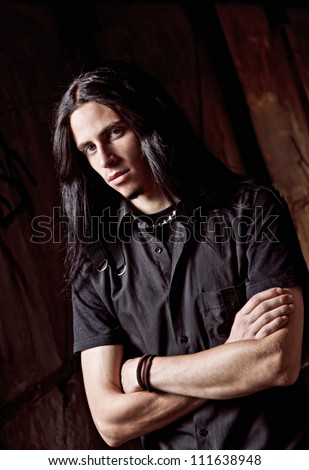 Closeup portrait of a long-haired handsome young man - stock photo