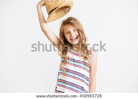 Closeup portrait of a lovely little girl with straw hat against a white background - stock photo