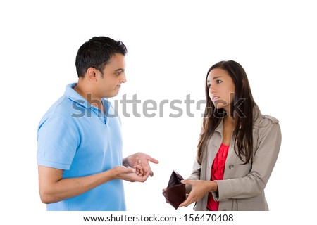 Closeup portrait of a man and woman showing empty wallet to her husband, being broke and poor, asking for more money, isolated on white background. FInancial difficulties, job loss, reckless spending - stock photo