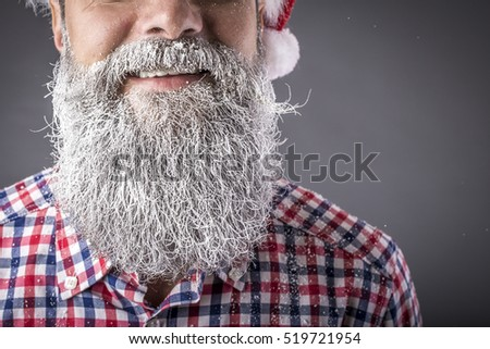 Closeup portrait of a man frozen beard .Winter and Christmas time