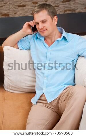 Closeup portrait of a man using a cellphone - stock photo