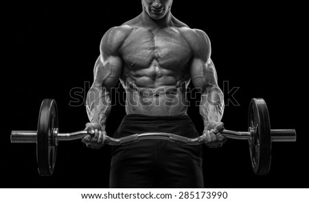 Closeup portrait of a muscular man workout with barbell at gym. Brutal bodybuilder athletic man with six pack, perfect abs, shoulders, biceps, triceps and chest. Black and white photo - stock photo