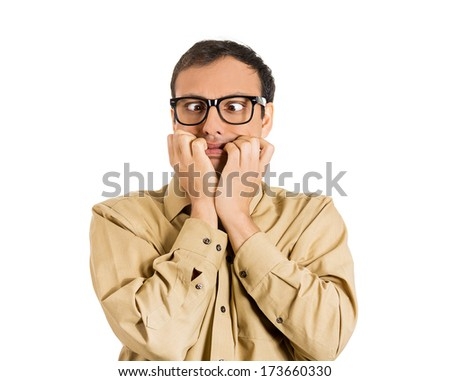 Closeup portrait of a nerdy guy, anxious man with big glasses, biting his finger nails craving something scared, eyes crossed isolated on white background. Negative human emotions, facial expressions - stock photo