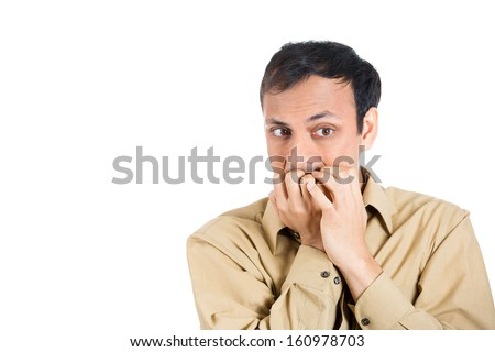 Closeup portrait of a nerdy guy with biting his finger nails with a craving for something or anxious, isolated on white background with copy space. Negative human emotion