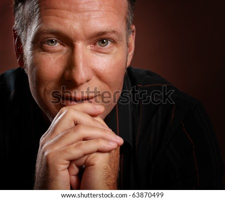 closeup portrait of a nice middle age man - stock photo