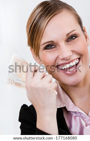 Closeup portrait of a pretty female with a bunch of Euro notes - stock photo