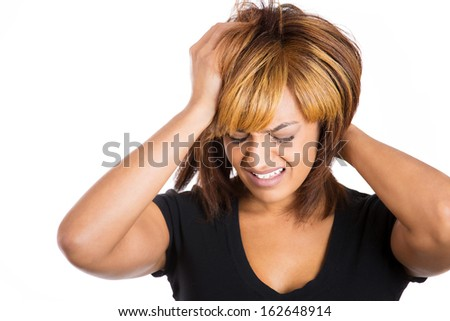 Closeup portrait of a sad, depressed, thoughtful young woman, having headache pain placing hand on hair isolated on white background copy space to left. Negative human emotion facial expressions - stock photo