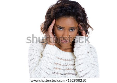 Closeup portrait of a sad, depressed, thoughtful young woman, having headache pain placing hand on hair, isolated on white background copy space to left. Negative human emotion facial expressions  - stock photo