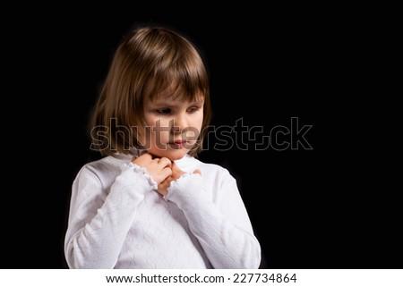 closeup portrait of a sad little girl - stock photo